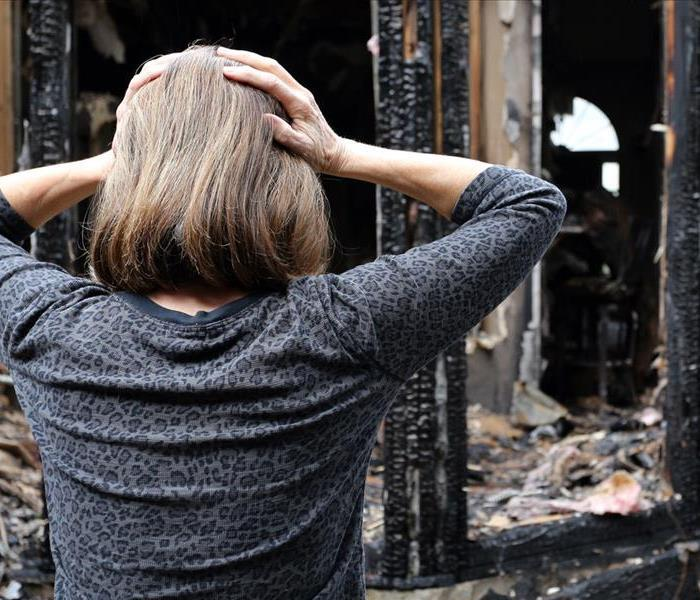 woman surprised by fire damage